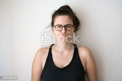 876629044istockphoto Woman posing in glasses 1054463206