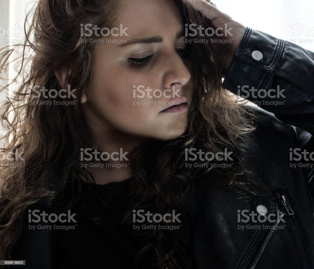 Woman posing in leather jacket stock photo