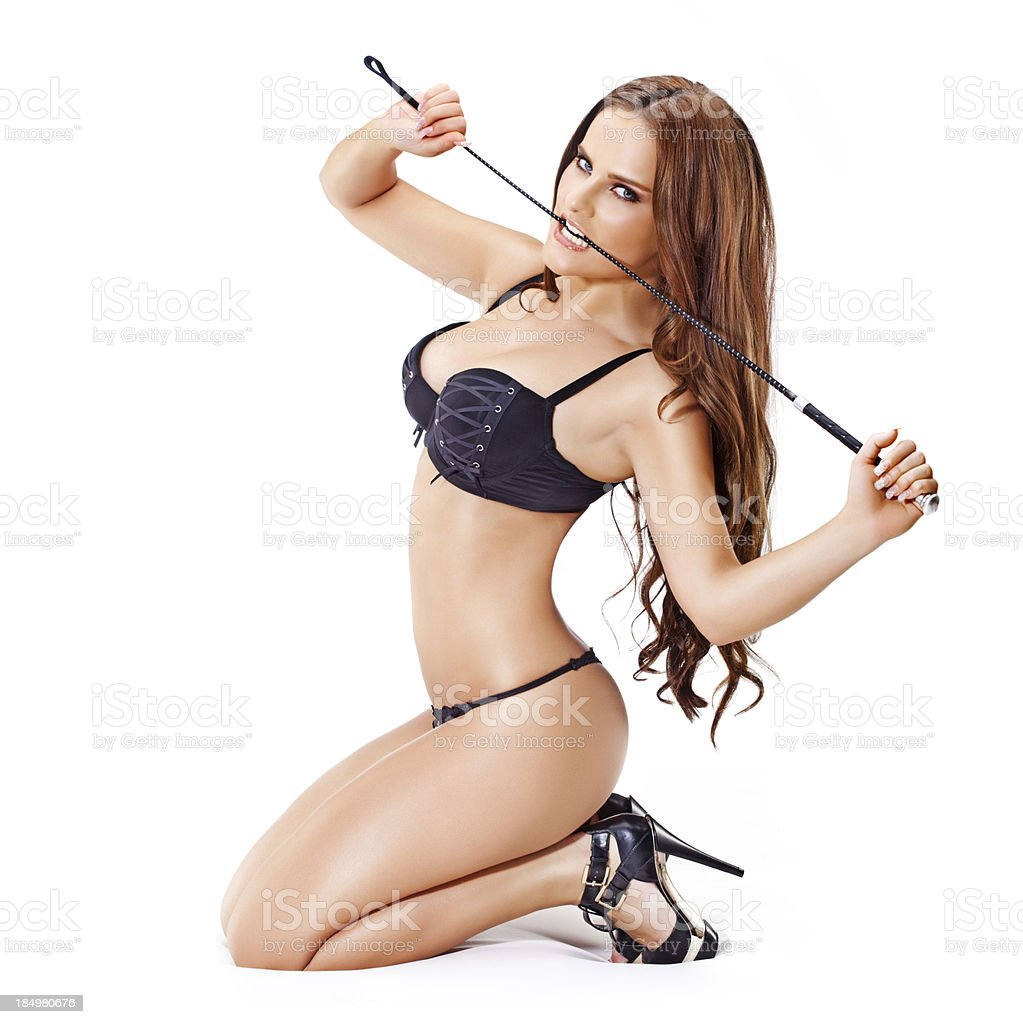 woman posing in lingerie with whip royalty-free stock photo