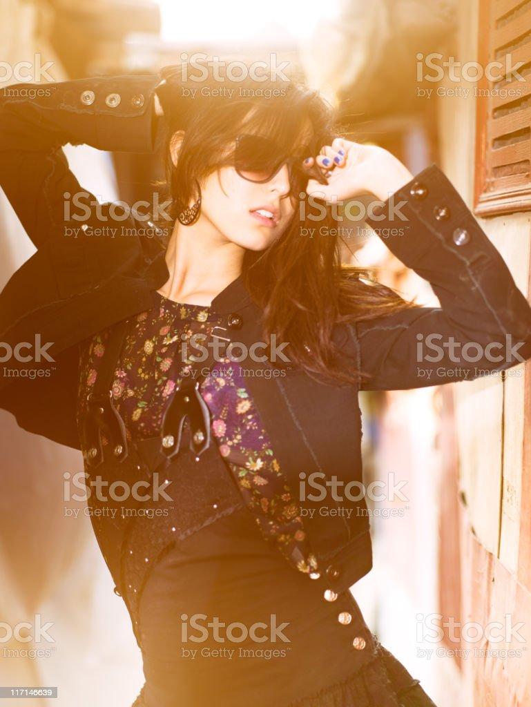 Woman posing in narrow corridor against the sun royalty-free stock photo