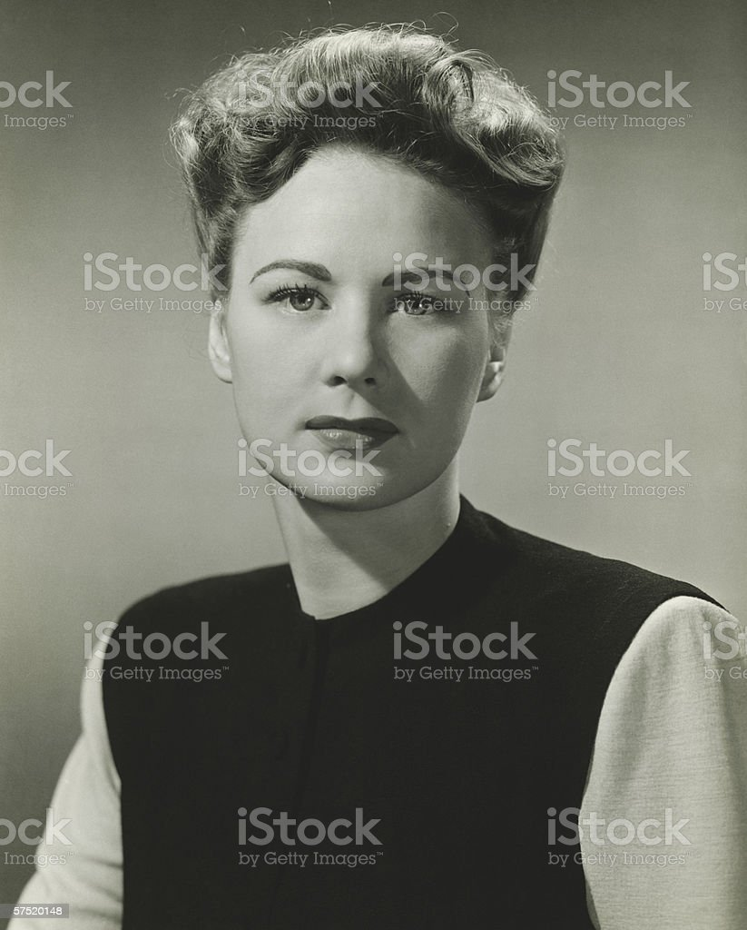 Woman posing in studio, (B&W), portrait stock photo