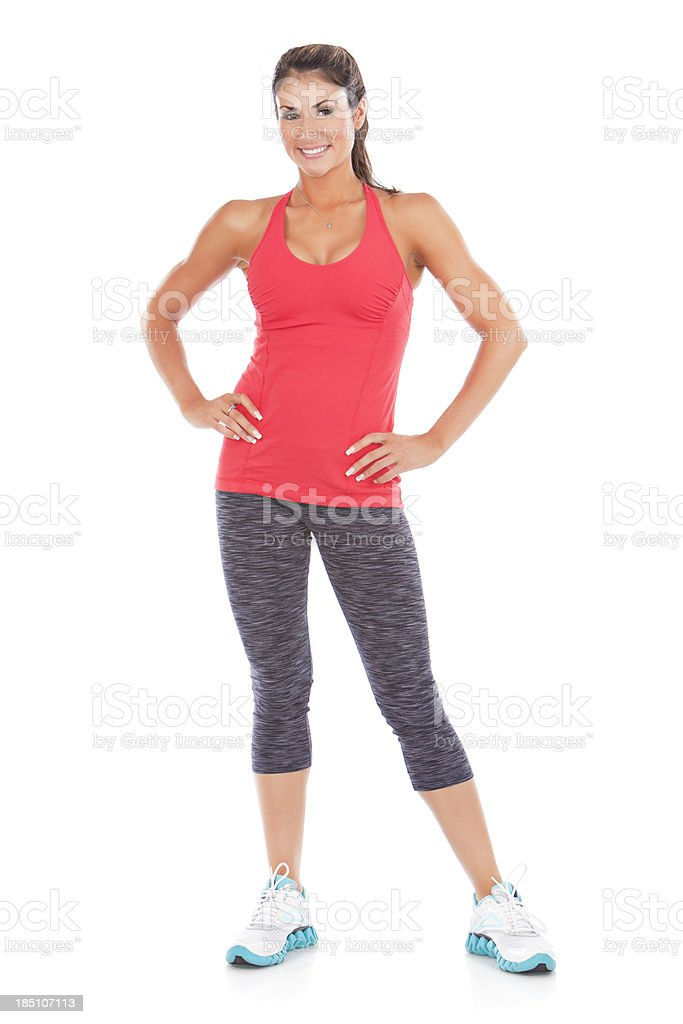 Woman posing in workout clothes with hands on hips stock photo