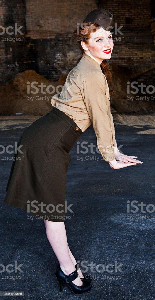 Woman Posing in WWII Nurse Uniform stock photo