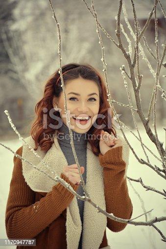 istock Woman posing looking at camera in winter 1170947787