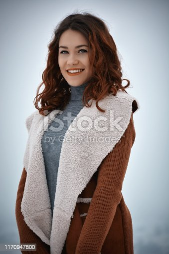 1051172208 istock photo Woman posing looking at camera in winter 1170947800