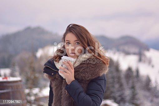istock Woman posing looking at camera in winter 1170947801