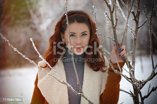 1051172208 istock photo Woman posing looking at camera in winter 1170947864