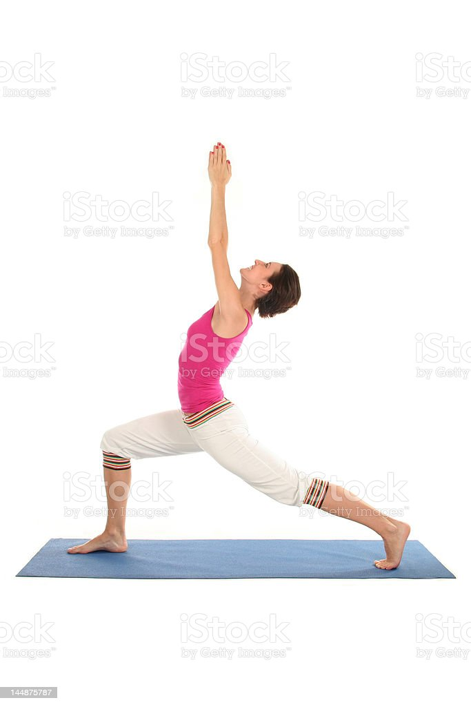Woman Posing On A Blue Yoga Mat royalty-free stock photo