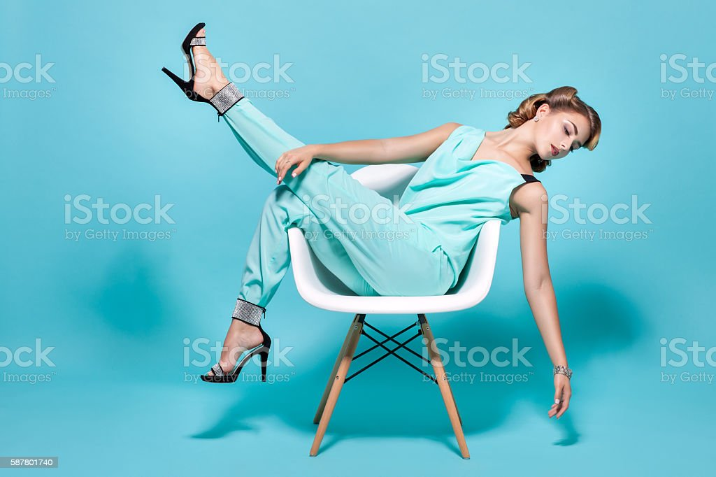 Woman posing on a chair. stock photo