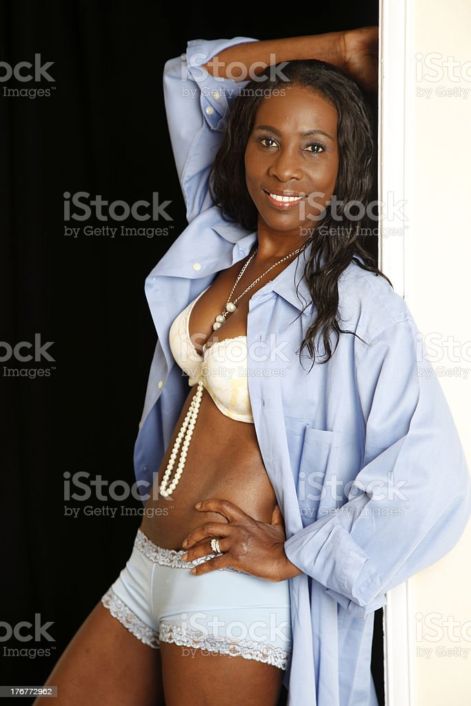 woman posing on door frame royalty-free stock photo