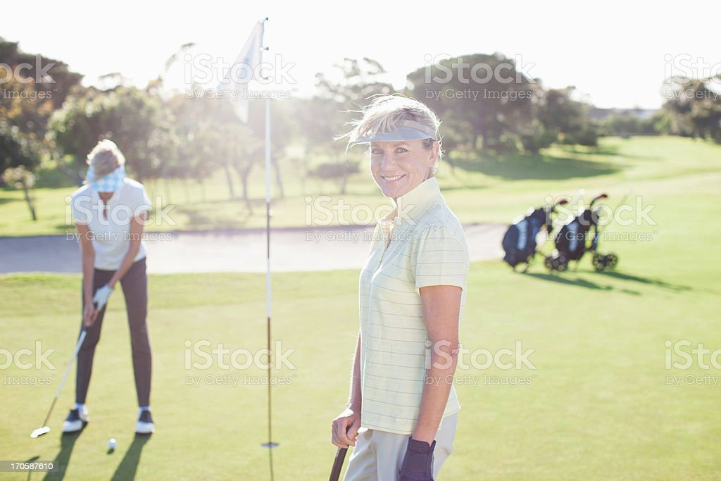 Woman posing on golf course royalty-free stock photo