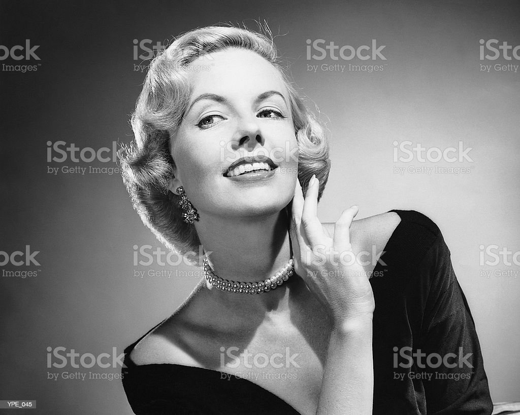 Woman posing, touching face with hand royalty-free stock photo
