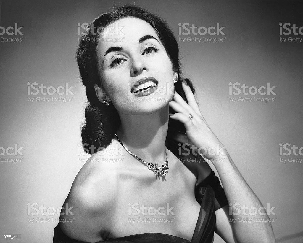 Mulher Posando, tocar o rosto com uma mão foto de stock royalty-free