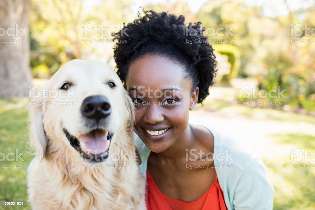 Woman posing with a dog stock photo