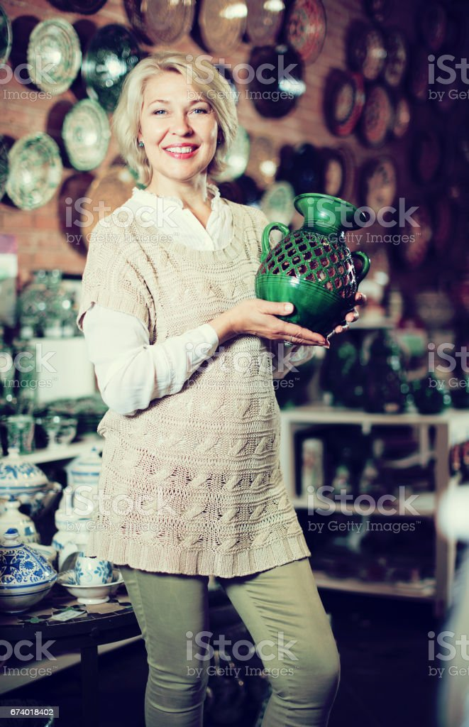 Woman posing with ceramic tableware royalty-free stock photo