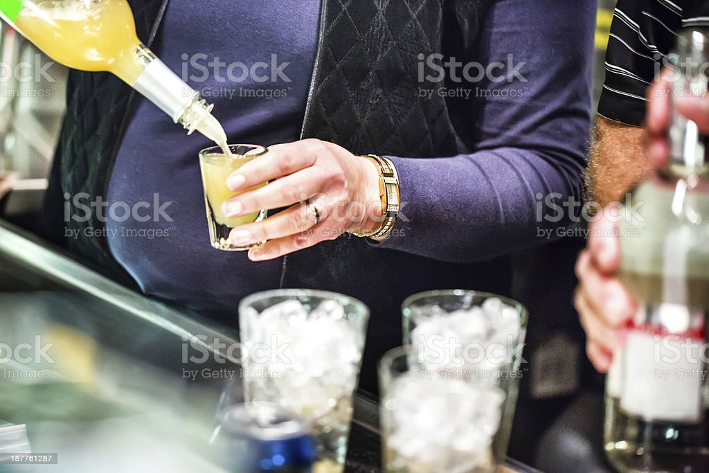 Woman pouring an alcoholic drink on New year's Eve royalty-free stock photo