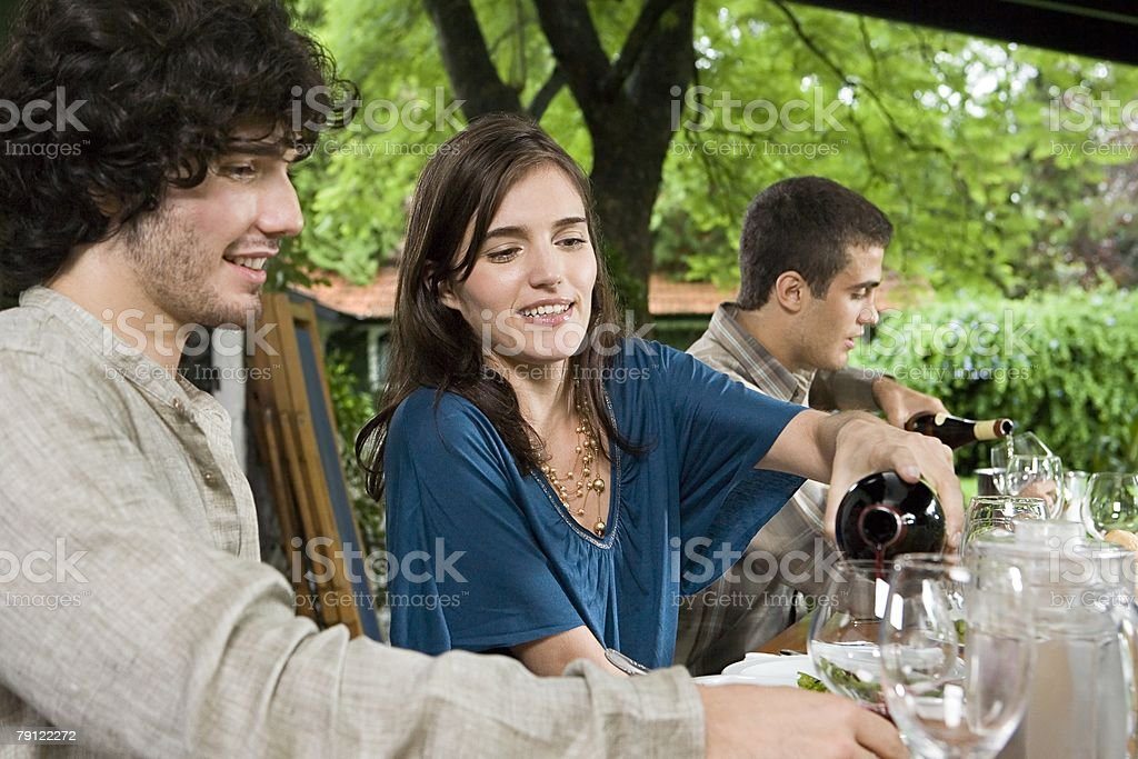 Woman pouring man a glass of wine 免版稅 stock photo