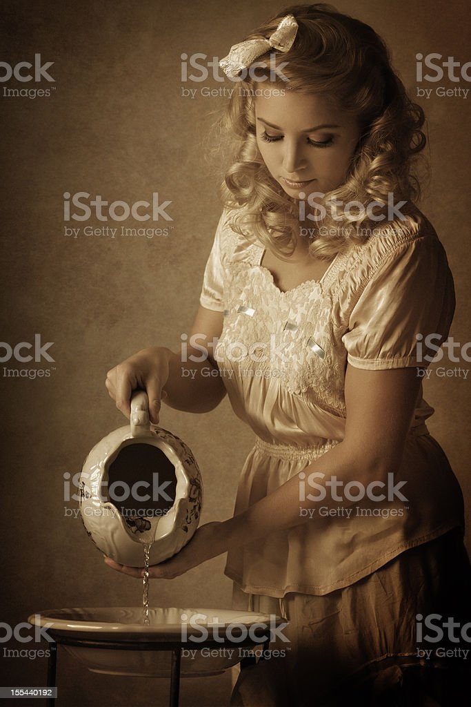 woman pouring water stock photo