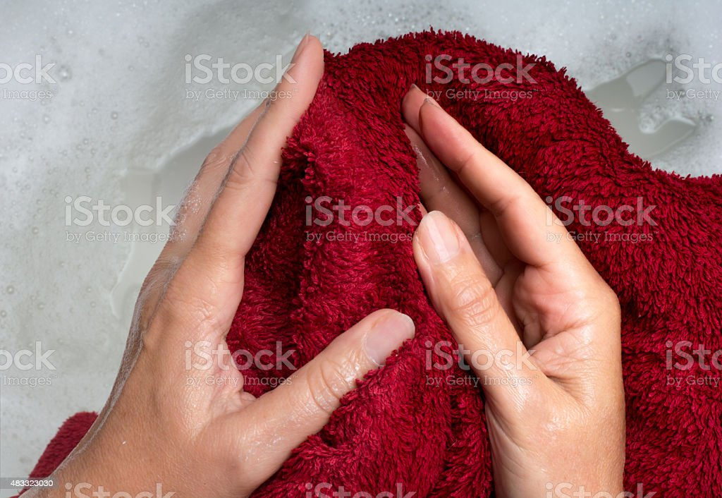 Woman pov drying hands stock photo
