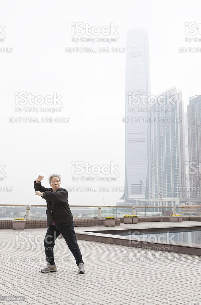 Woman practices Tai Chi in Hong Kong royalty-free stock photo
