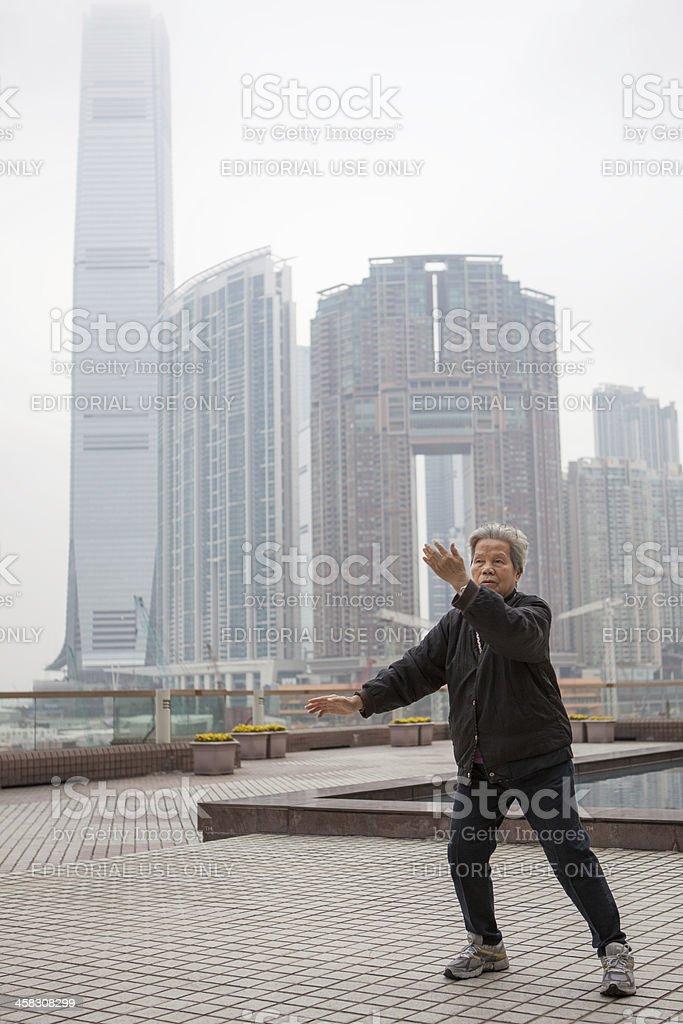 Woman practices Tai Chi in Hong Kong royalty-free stock photo