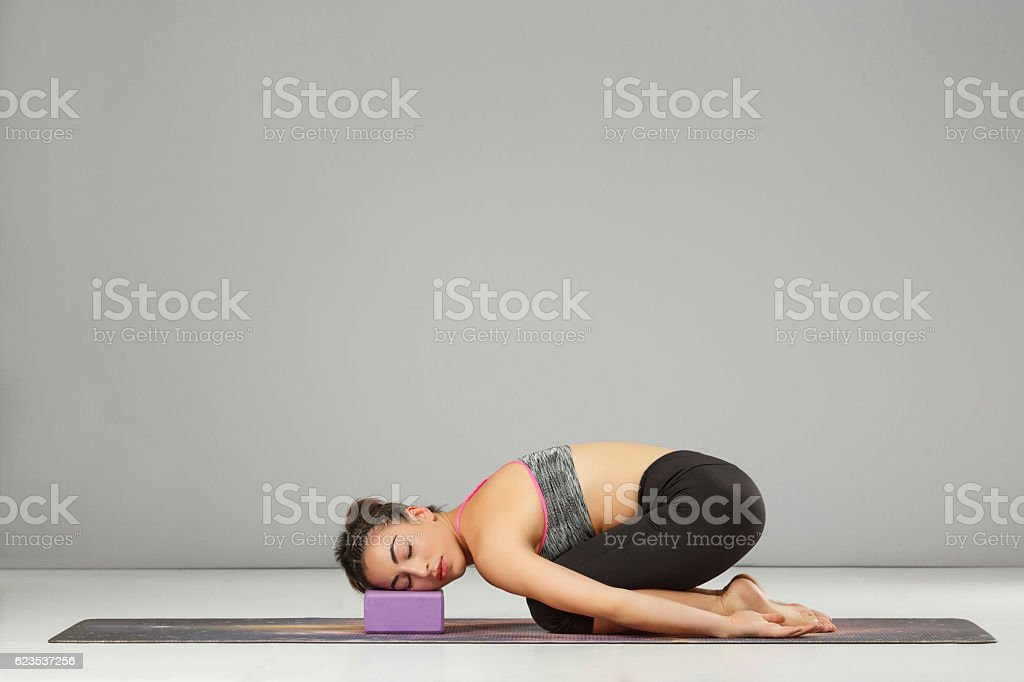 Woman Practicing Advanced Yoga Pilates Stretching Training Yoga Block Poses Stock Photo Download Image Now Istock