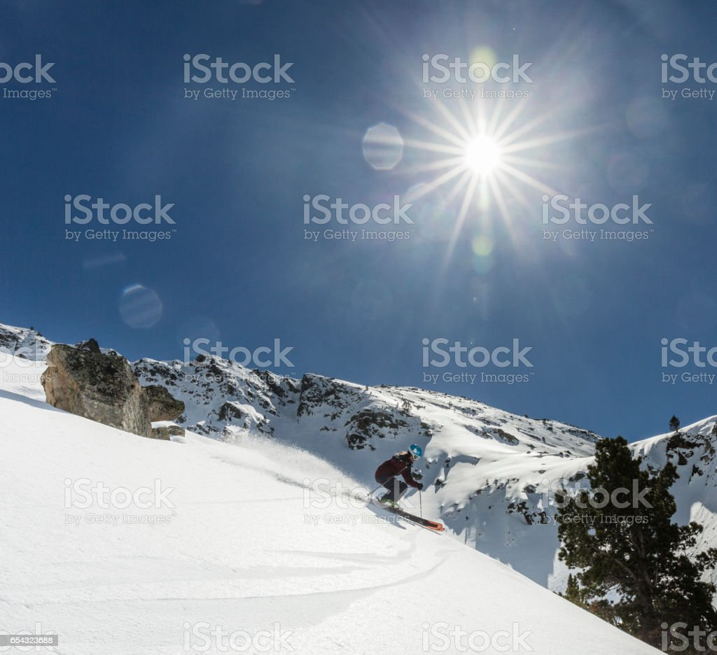 Woman practicing Backcountry skiing stock photo