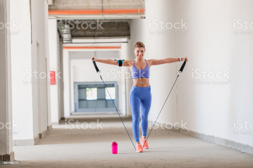 Woman practicing hard indoors royalty-free stock photo