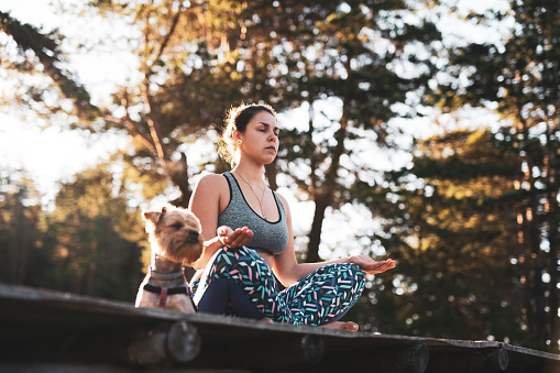 Woman practicing meditation outdoor.