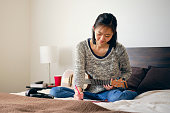 istock Woman Practicing Musical Instrument 1219771367