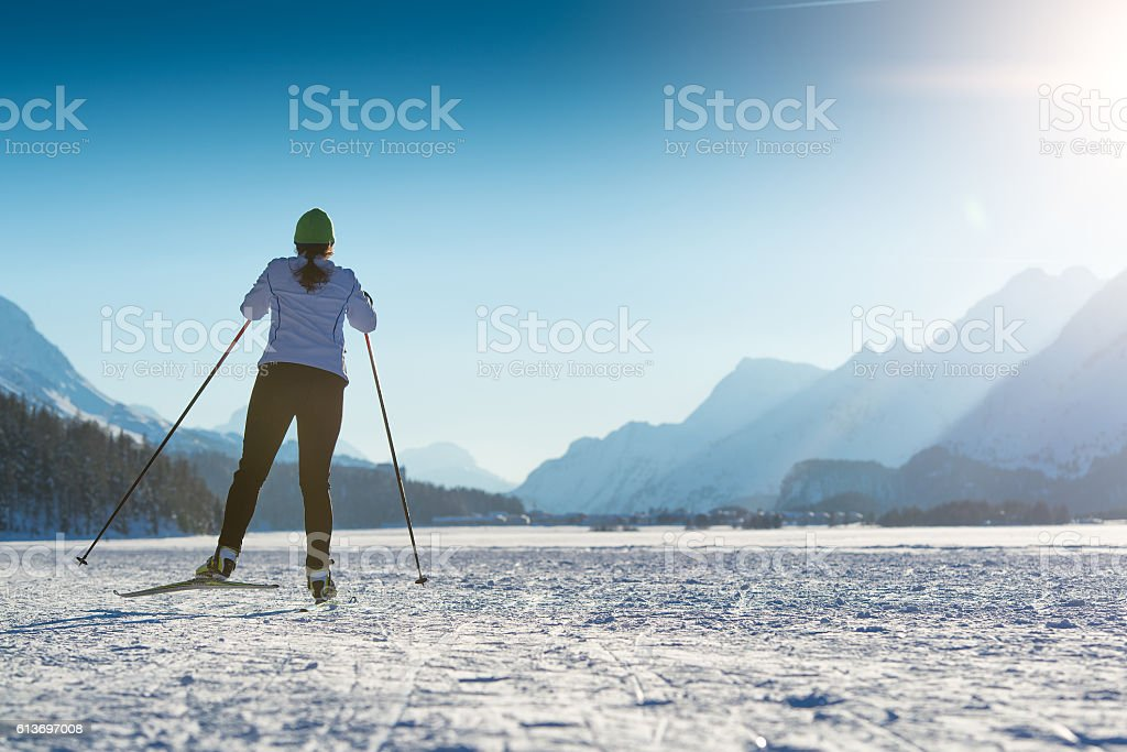 Woman practicing Nordic skiing stock photo