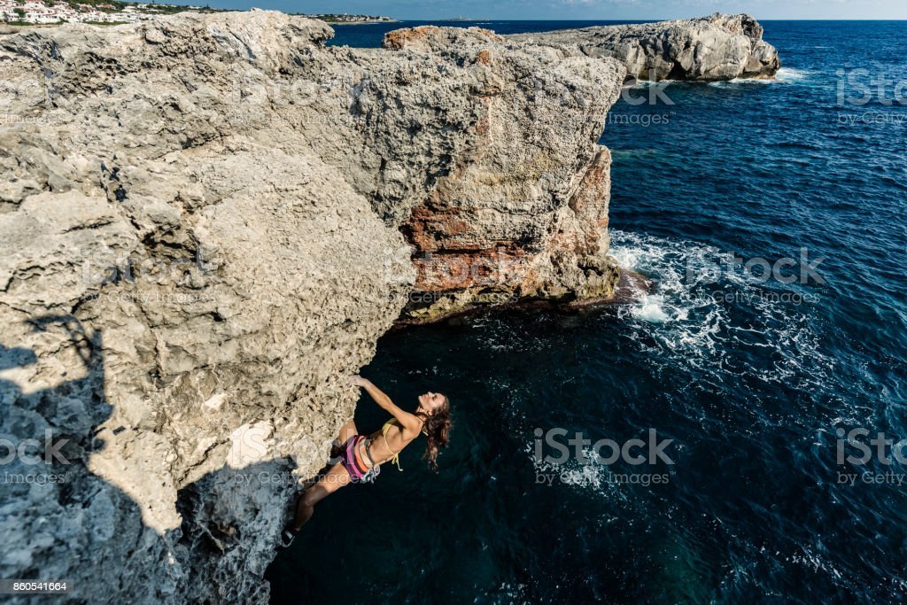 Woman practicing psicobloc rock climbing stock photo