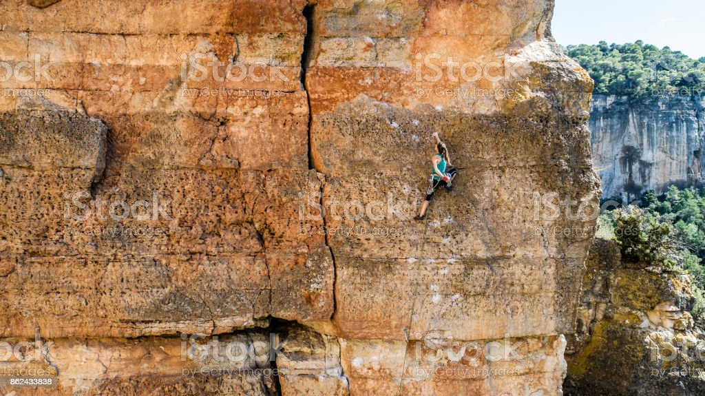 Woman practicing rock climbing in Siurana Catalonia stock photo