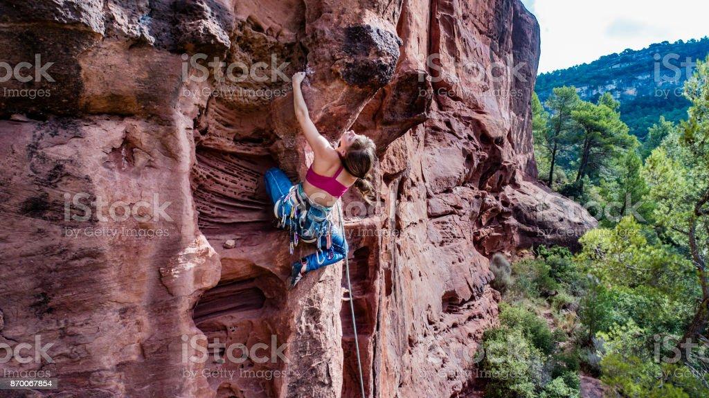 Woman practicing rock climbing in Siurana Catalonia stock photo