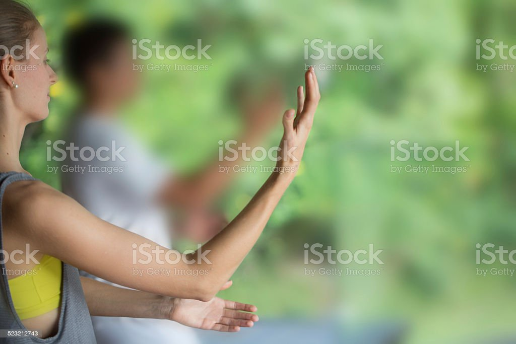 Woman practicing taichi stock photo