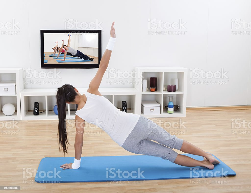 Woman practicing yoga at home stock photo