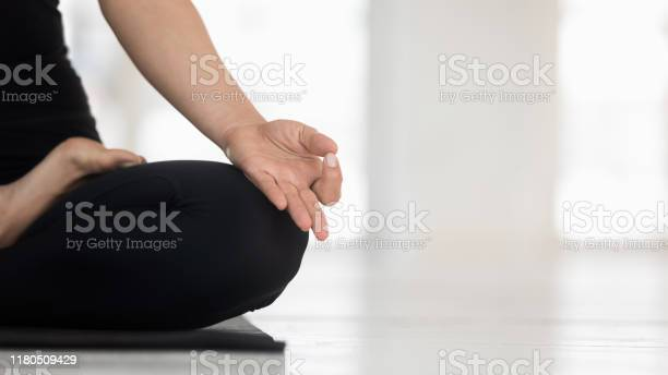 Woman practicing yoga doing padmasana exercise lotus pose close up picture id1180509429?b=1&k=6&m=1180509429&s=612x612&h=xsi gngfkd4cokrpswhjmrj 8n qzgrik2uxothksre=