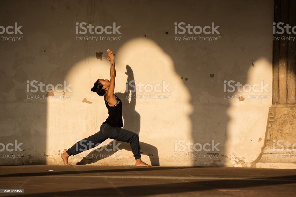 Woman practicing yoga in India. stock photo