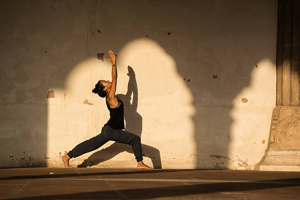 Woman practicing yoga in India. Woman practicing yoga in New Delhi, India. sun salutation stock pictures, royalty-free photos & images