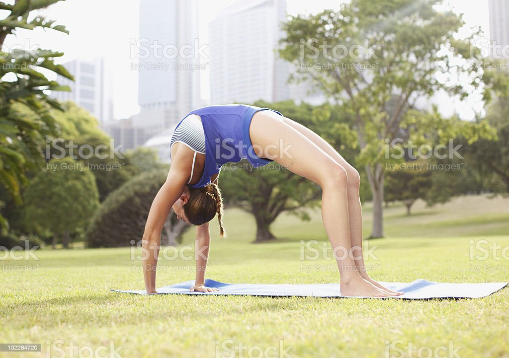 Woman practicing yoga in park royalty-free stock photo