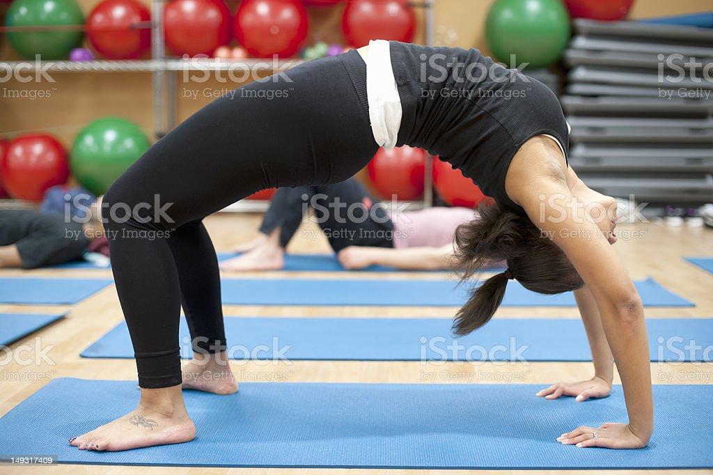 Woman practicing yoga in studio stock photo