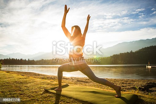Meditation and yoga practice at sunset or sunrise.