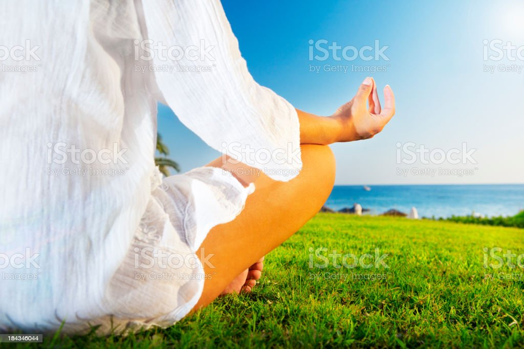 Woman practicing Yoga outdoor in nature royalty-free stock photo