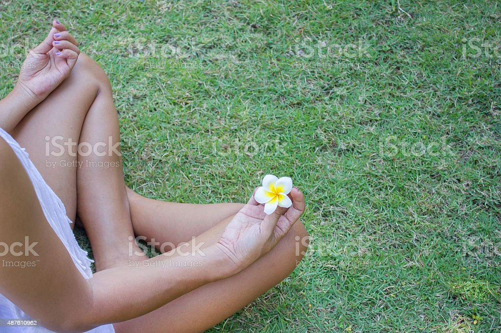 Woman practicing yoga outside stock photo
