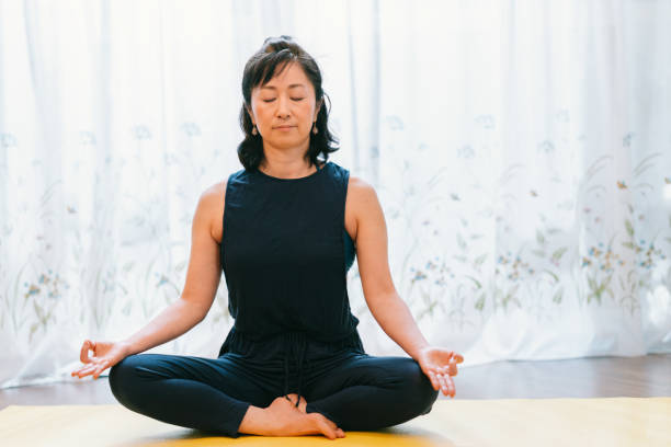 woman practicing yoga - meditation stock pictures, royalty-free photos & images
