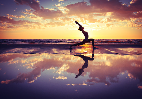 Woman Practicing Yoga Stock Photo - Download Image Now
