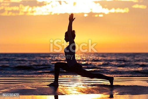 istock woman practicing yoga 502732472
