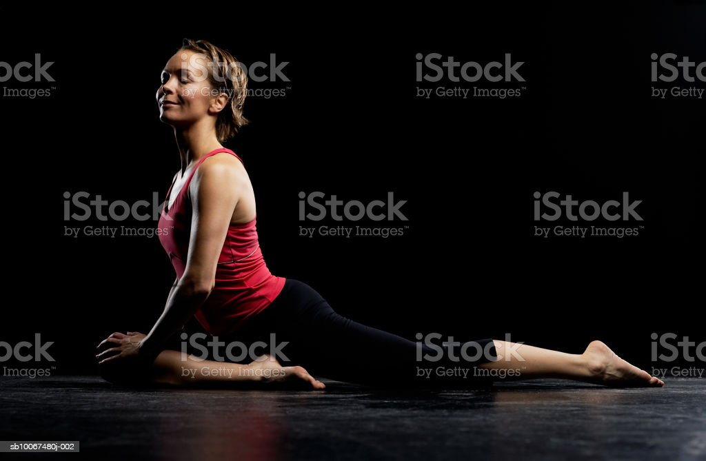 Woman practicing yoga, smiling Lizenzfreies stock-foto