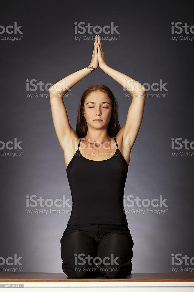 Woman practising yoga. royalty-free stock photo