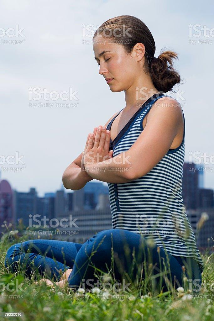 A woman practising yoga 免版稅 stock photo